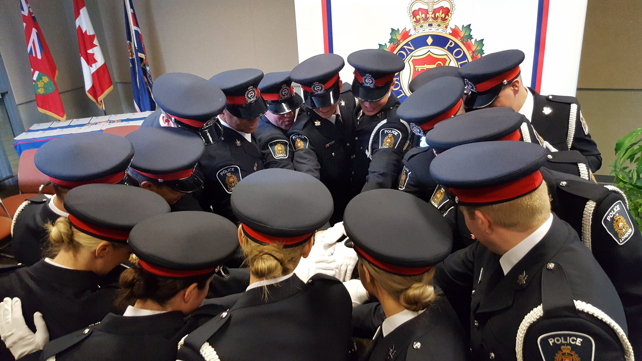 Group of Officers Joining Hands